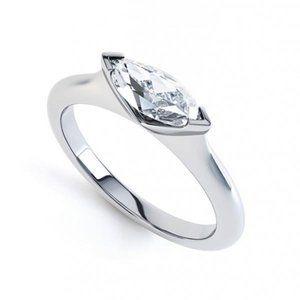 1.25 carat bezel set marquise cut diamond wedding